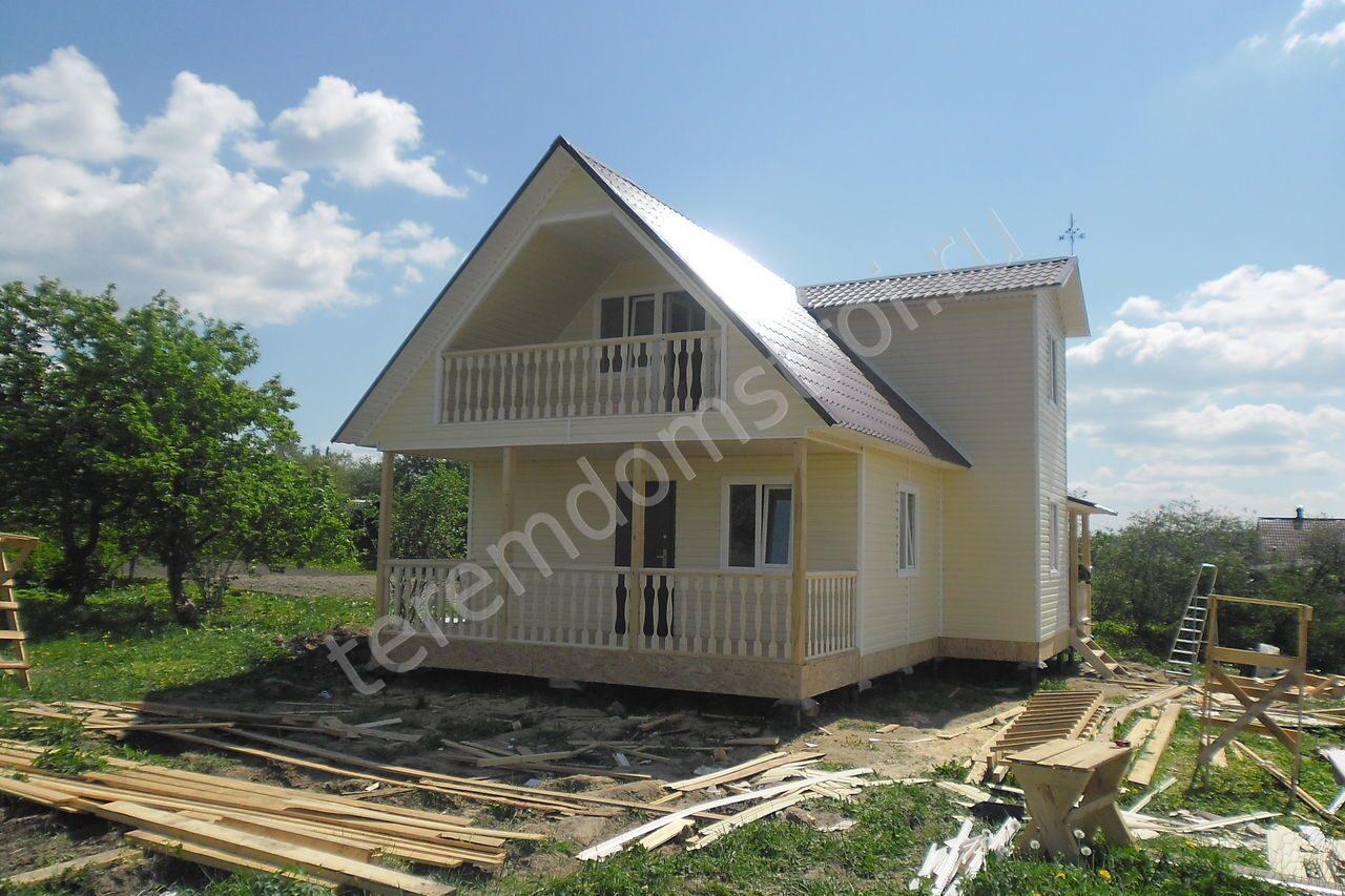 Каркасный дом с террасой и балконом фотографии построенные д.